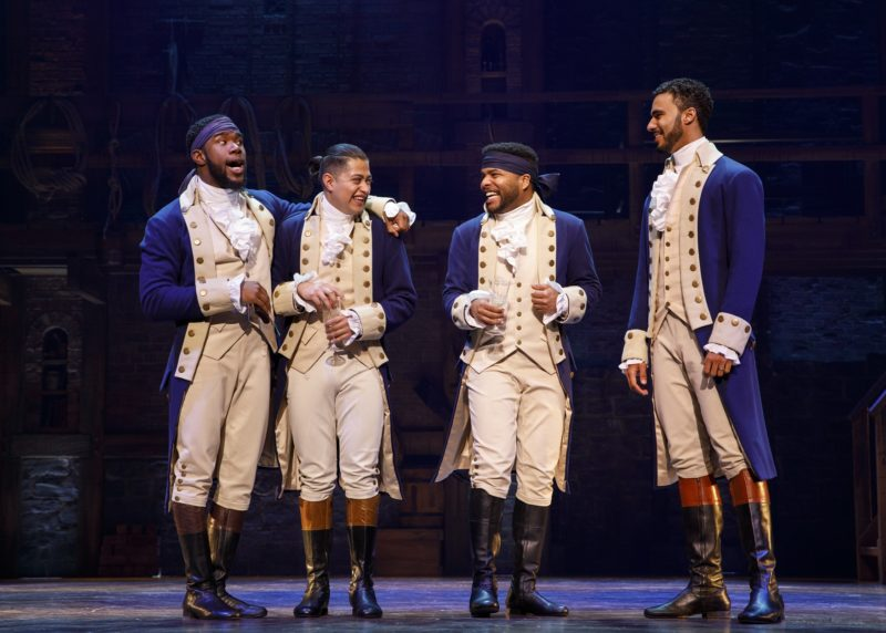 Friends Aaron Burr, Marquis de Lafayette, Hercules Mulligan and Alexander Hamilton joke around after Hamilton's wedding.