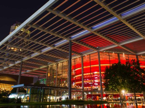 An exterior photo of the exterior of the Winspear Opera House at the AT&T Performing Arts Center in downtown Dallas, TX.